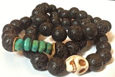 lava and carved wood skull bracelets...Theodosia Jewelry