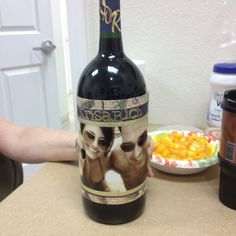 "Going away present. Relabeled a wine bottle with our picture and named it ""krisarich"" for Kristen, Sarah, and Richard."