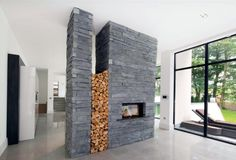 Architecture, Modern Fireplace That Acts As Divider Between Cooking And Living Area: Sleepy Hollow: Luxurious Contemporary House Designed By. Modern Fireplace, Fireplace Design, Fireplace Ideas, Living Room Manchester, Manchester Uk, Interior Architecture, Interior Design, Amazing Architecture, Stone Cladding