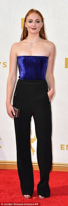 Classy: The British actress teamed a rich purple velour top with slinky black high-waisted trousers