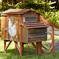 Reclaimed Rustic Coop with Painted Chicken  Run  #WilliamsSonoma. Can I hide this in the backyard without neighbors (and husband) noticing? I want chickens, he wants a dog...