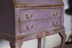 """It's had the Jonathon Marc Mendes Painted Love treatment. """"To start with I spray-painted the interior gold and the #ChicMouldings too, I then applied the mouldings and gave it three coats of chalk paint by Annie Sloan in French Linen, Château Grey, with a little Olive, and the final coat was Emile. Once all dried I used the wet distress technique by applying a colourwash of Cream and then wiping back the layers of colour showing the gold and corresponding colours from underneath."""""""