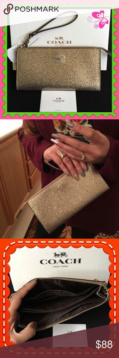 """Authentic Coach Clutch % AUTHENTIC✨ Stunning zipped gold large clutch / wallet / wristlet from Coach!  Length 8"""" Height is almost 4 1/2"""" Width 1"""" ( iPhone 6s Plus will fit in here ) Lots of space for your cash and cards. Exterior back zipped compartment. New w/ tag! PRICE IS FIRM! Coach Bags Clutches & Wristlets"""