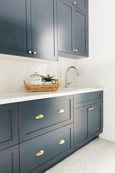 Studio McGee is my FAV - you should check them out. Example of a Navy kitchen - Navy cabs, herringbone floor, brass hardware- Navy and Brass Laundry Room Blue Laundry Rooms, Laundry Room Cabinets, Blue Cabinets, Shaker Cabinets, Kitchen Cabinets, Cupboards, Laundry Room Island, Laundry Room Colors, Laundry Room Tile