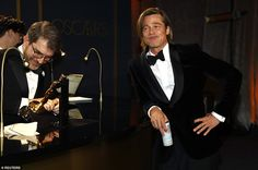 Letting his hair down: Brad Pitt led the way as the biggest winners at the 92nd Academy Aw...