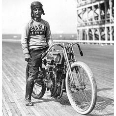 Joe Wolters onboard a fresh, rivet-tank Harley-Davidson 11k at Chicago's 2-mile long board track at Speedway Park, September 12th, 1915. A Chicago native, Joe was one of the first racers in the country to proudly wear the jersey of the newly developed Harley-Davidson factory team. Harley, who were having a strong showing in 1915, the debut season of the factory racing program, was in Chicago to compete in the 300 mile race. Joe, who had been nursing an injured left foot for weeks had to get…