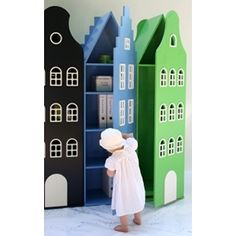 Dutch rowhouse children's storage, reminiscent of our Delft porcelain houses from KLM. Love it!