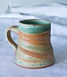 This porcelain mug was fired in the Albion Anagama, one of the largest and oldest wood kilns in America. The Albion Anagama resides in Albion