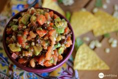 """I have a real treat for you today! I love when I get to share """"super secret"""" family recipes for the first time with the whole world. :-) Last week my sister-in-law Denise decided to finally give up her special salsa recipe that has been tantalizing tastebuds for years. I know she's had loads of …"""