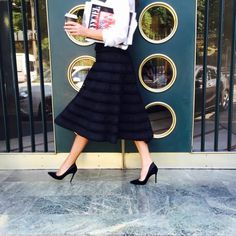Gianvito Rossi pumps and a ladylike black midi skirt