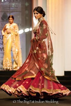 Ashima Leena two tone red and green Mughal influence lengha.  Her necklace is stunning too