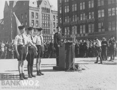 1930's. Director of the Nationale Jeugdstorm C. van Geelkerken speaks at Dam square in Amsterdam. Van Geelkerken co-founded the NSB with Anton Mussert and became later director of the Nationale Jeugdstorm (NJS), a political youth organization modeled after the German Hitlerjugend. Photo NIOD / A. G. Swart. #amsterdam #1930 #NSB #Geelkerken #Mussert