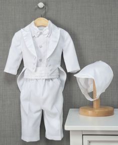 He can't look anymore dapper for his big day than in this darling tuxedo and matching bonnet. Perfect for the big event and church-going Sundays to come. | Polyester; Shirt: Polyester/cotton | Dry cle
