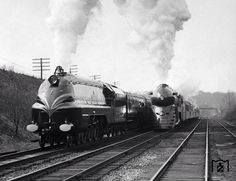 """LMS Corination Class"""" duchess of Hamilton """" on her american tour 1939 running parallel with Baltimore and Ohio loco which iam not sure of her type."""