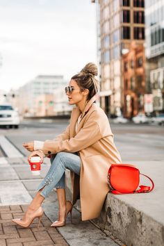 A classy chic coat with a pop of bold color