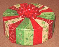 How to gift wrap a round box: all finished, with a nice bow on top.