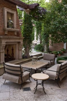 Outdoor sitting area with fireplace.love love love!!! Tiles on the floor...cozy....big tree. Fireplace