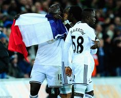 Bafetimbi Gomis celebrates the equaliser against West Ham by displaying the France national flag to commemorate the innocent people who died in Paris terrorist attack. Final score 1-1