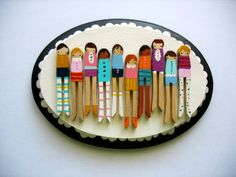 Painted clothespins.  How cute would this be if it was a family on a plaque?