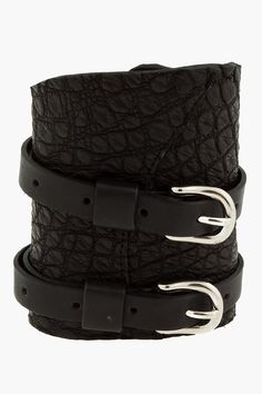 Balmain Black Croco_embossed Buckle Cuff -  Balmain Black Croco_embossed Buckle Cuff Balmain Irregular_cut leather wrist cuff in black. Crocodile skin texture embossed throughout. Twinned buffed leather adjustable cinch belts with silver_tone pin_buckle closures. Tonal stitching. Approx. 9.5 length. 4 width Price $900.00 Click HERE for...