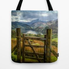 Tote Bag Valley Gate by Adrian Evans from $18.00