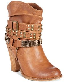 Studs and rhinestones #decorate the Not Rated double dip booties, adding #shine and #glamour in a welcome way. By Naughty Monkey.      Imported     Man-made upper     Round closed-toe double-dip booties with stud and rhinestone details     2-1/2″ heel     Man-made sole