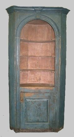 18th c. painted corner cupboard with arch and keystone in original blue paint. google.com