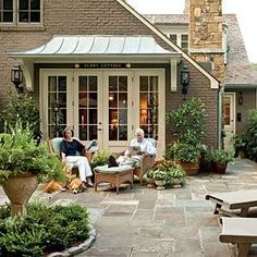 love the metal roof awning....adds a lot of character to an otherwise ordinary french door - would also work over a slider door.