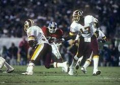 Doug Williams hands off to Timmy Smith in Super Bowl XXII.