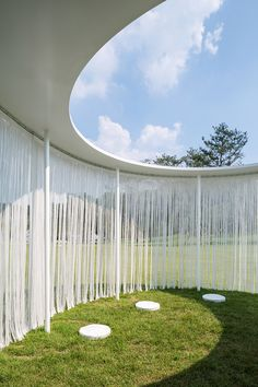 Seoul studio OBBA hung thin white strips around this temporary pavilion, designed as a resting place for visitors to an outdoor art exhibition.