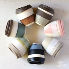 Reusable Ceramic Takeaway Cups with silicon lid and sleeve by Kim Wallace Ceramics