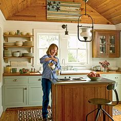 Reclaimed heart pine counters, open shelves, and a vaulted ceiling exude vintage charm | Coastalliving.com