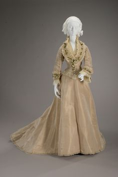 1875 wedding dress, silk satin, orange blossoms, silk net with cotton petticoat Label: I. W. CALEY Dress and Mantle Maker via Indianapolis Museum of Art