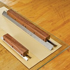 Just pop your planer or jointer knives into the two brass slots, cinch down the lock nuts, and with a few strokes on progressively finer sheets of sandpaper, you'll have an edge that rivals that of the finest handplanes.