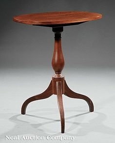 An American Federal Mahogany Candlestand, early 19th c., Baltimore, oval tilt top, ring and baluster turned support, arched legs, height 29 in., width 24 in., depth 18 1/2 in