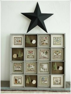 Casier vertueux! Little House Needlework sheep - love the finishing in the shadow box & button sheep
