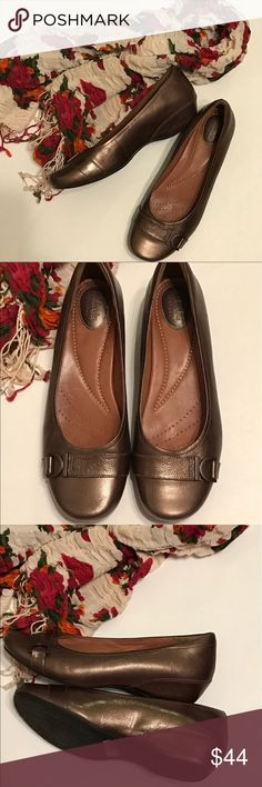 Clarks Artisan shoes Dark brown, metallic leather, Clarks Artisan shoes with small wedge. Cute buckles on front of shoes. Excellent condition. Super comfortable and stylish. Size 10M. Clarks Shoes Wedges