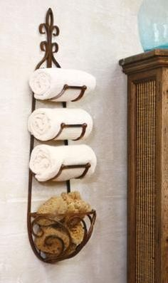 """Wine Rack"" for a towel holder - I have had something similar to this in my bathroom for 10 years. I have no cabinets for towels, so it is perfect!"