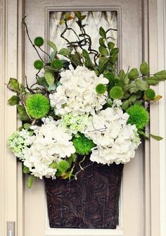 """note placement of large pieces; could paint my tin """"vase"""" a light color and fill w/ cotton for summer"""