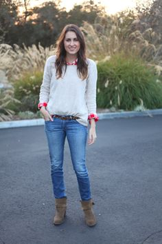 Pair your favorite jeans with boots and a sweater for an effortless winter look.