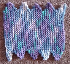 Zig Zag Dishcloth -  Super easy, something fun to try for beginners!  It is a good way to introduce a  new stitch pattern, with easy increasing and decreasing. Get a group of ladies or teens together and all work on this easy project , and see who finishes their first!  Use up scraps of worsted weight yarn too! Makes a good dishcloth, or use as a dust cloth, car washing cloth!  Uses US # 10 needles. Finished size is about 10 by 10 1/2 inches. $1.00