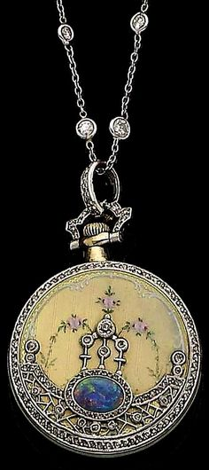 A belle époque opal, enamel and diamond fob watch, by Tiffany & Co., circa 1905 The circular dial with Roman numerals to a gold and green enamel bezel, the reverse decorated with polychrome floral enamel detailing, overlaid by rose-cut diamonds and an oval cabochon opal, to a spectacle-set old brilliant-cut diamond chain, diamonds approx. 0.40ct total, dial signed Tiffany & Co., movement signed by Edouard Koehn, lengths: pendant 4.0cm, chain 45.4cm