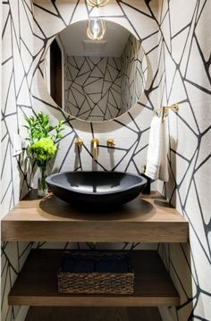 A powder room with unique textures of geometric patterns and a black stone basin. A powder room with unique textures of geometric patterns and a black stone basin. Powder Room Vanity, Powder Room Wallpaper, Powder Room Decor, Powder Room Design, Rustic Powder Room, Geometric Wallpaper Powder Room, Modern Farmhouse Powder Room, Bold Wallpaper, Powder Room Mirrors