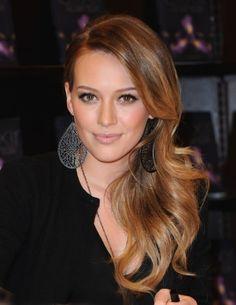 love her hair, makeup, earrings, everything!