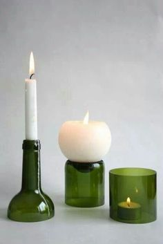 Candles on cut wine bottle