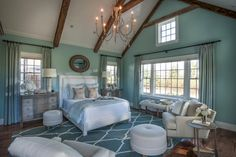 The master bedroom from HGTV Dream Home 2015 combines neutrals with calming shades of blue as a nod to the soft coastal style found in the Cape Cod home. According to interior designer Linda Woodrum, the space is intended to be a calming, tranquil room that makes its inhabitants instantly relaxed.