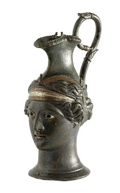 Herculaneum: Ornamental Head of a Woman: the bronze head in the shape of a jug, has no base & was purely decorative