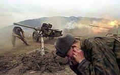 Russian artillery shell militant positions near the village of Duba-Yurt in January 2000.