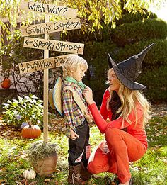 prop idea: Halloween Decor: A Spooky Street Sign    Use black paint to write Halloween-theme street names such as Witch Way, Goblin's Gorge, and Pumpkin Place on pieces of scrap wood, then nail the pieces at various angles to a 5-foot-tall garden stake. Stick the stake in the ground or into a large planter.