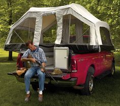 A truck camper pop up tent. Awesome idea.